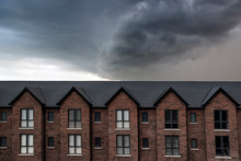 Dramatic Upcoming Storm Cloud Over England Buildings / Supercell Forming Weather Forecast City Urban Houses