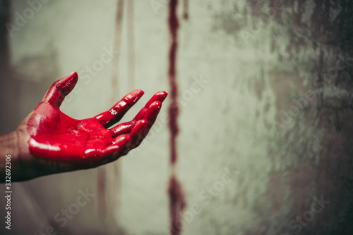 Obraz Close up of bloody hands in abandon house background. Horror and ghost concept. Criminal and murder concept. Halloween day and sacrifice theme. People and religion theme. Open the palm of the hands. - fototapety do salonu