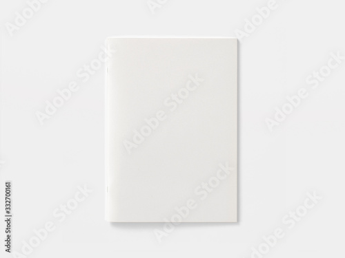 Fototapeta Blank portrait magazine or brochure isolated on white