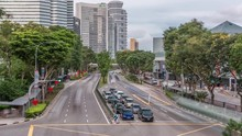 Traffic With Cars On A Street And Urban Scene In The Central District Of Singapore Aerial Timelapse. Nicoll Highway With Skyscrapers On A Background
