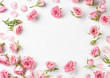 Rose flowers on white background with copy space for design, text. Top view of pink roses and rose buds.