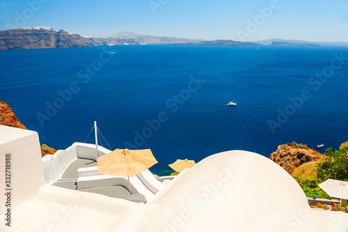 Fototapeta White architecture and blue sea on Santorini island, Greece. Beautiful terrace with sea view. obraz