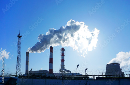 Canvas Smoking chimneys against a blue sky