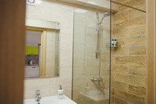 Modern En-suite Bathroom With Shower Cabin, Basin And Mirror.