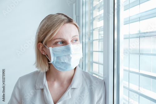 Woman nurse wearing face protection in prevention of Coronavirus, ebola, TB and other diseases Fototapet