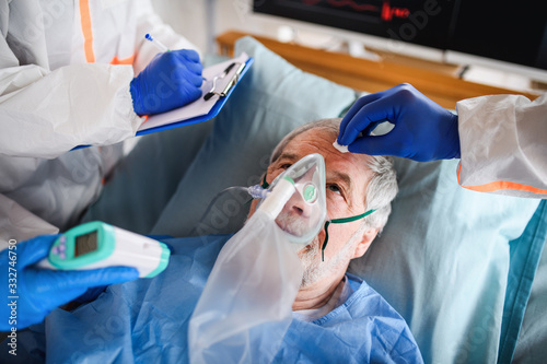 Infected patient in quarantine lying in bed in hospital, coronavirus concept.