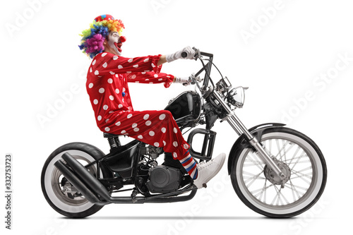 Canvas Print Excited clown riding a chopper motorbike