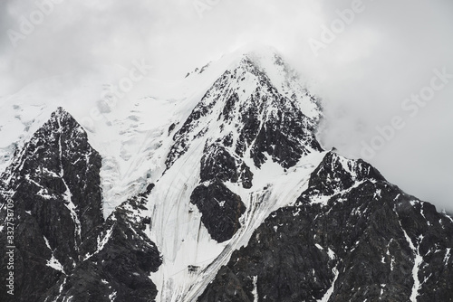 Atmospheric minimalist alpine landscape with massive hanging glacier on snowy mountain peak Fototapet