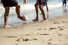 Male Feet Kick A Soccer Ball O...