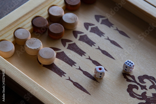 backgammona game of backgammon made of wood lies on a table Wallpaper Mural