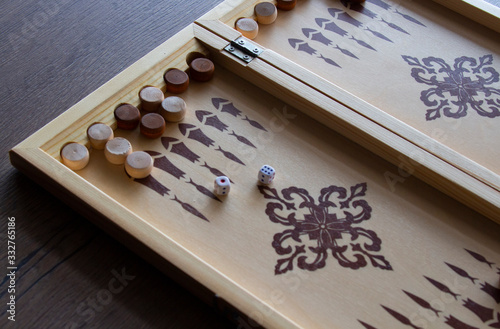 Fotografija backgammona game of backgammon made of wood lies on a table