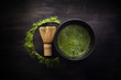 Leinwanddruck Bild - Matcha powder. Organic green matcha tea ceremony. Healthy drink. Traditional japanese drink on black wooden background