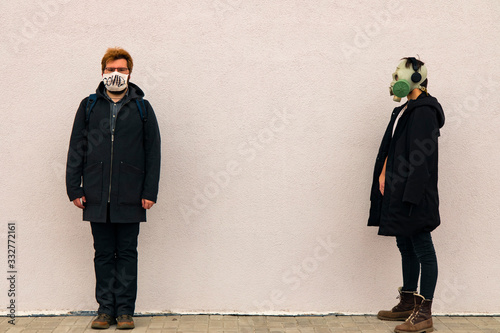 banter concept picture of two man portraits in medicine mask and gas mask hipste Wallpaper Mural