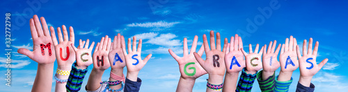 Stampa su Tela Children Hands Building Colorful Spanish Word Muchas Gracias Means Thank You
