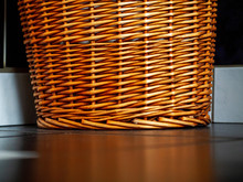 Wicker Laundry Basket On A Dar...