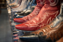 A Row Of New Shiny Men's Cowbo...