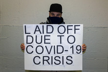 Unemployed Man With Poster Laid Off Due To Covid 19 Crisis
