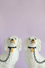 Two Porcelain Dogs On Pink
