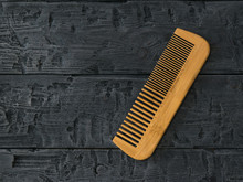 Wooden Comb Comb On A Wooden Background.
