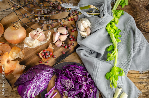 Cabbage, Onions, Garlic and dry fruits ready for vegetable salad over rustic old wood table