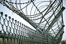 Border Fence With Barbed Wire....