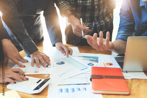 Business People Meeting using laptop computer, calculator,notebook,stock market chart paper for analysis Plans to improve quality next month Canvas Print