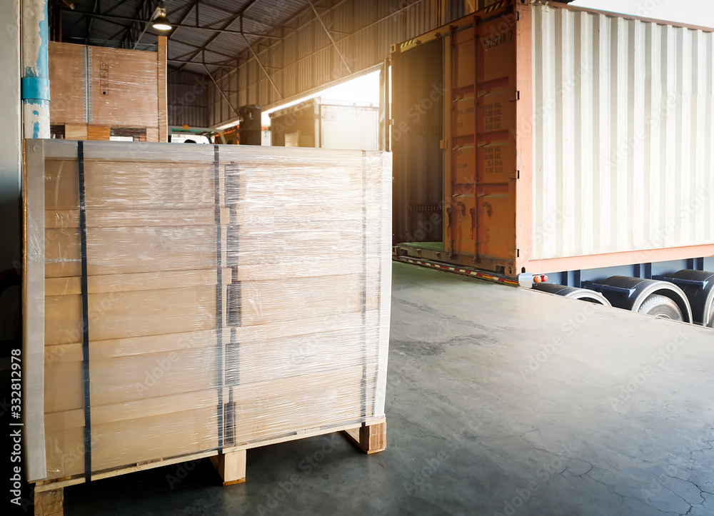 Fototapeta Interior of warehouse, Large pallet shipment boxes, Truck docking load cargo at warehouse, Road freight industry logistics shipping and transport