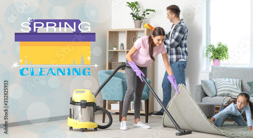Happy family cleaning flat together