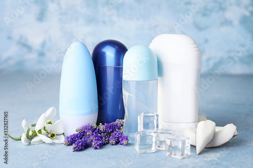Different deodorants on color background Canvas Print