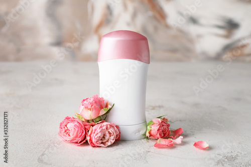 Deodorant and flowers on light table Canvas Print