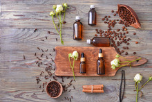 Bottles With Essential Oils On Wooden Background
