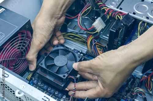 Fototapeta Technician computer repairing CPU cleaning for pc. In the computer service center obraz