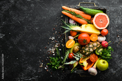 Fresh vegetables and fruits in wooden box. Organic food.