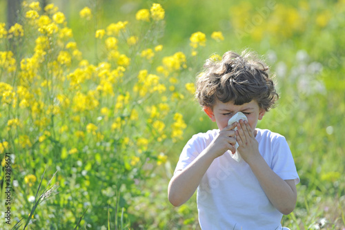 Little European caucasian  children  has allergies from flower pollen, boy has r Wallpaper Mural
