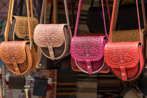 Fototapeta Female color embossed leather bags with carpathian pattern.