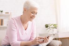 Senior Woman Chatting On Smart...