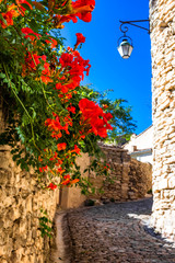 Narrow street in Gordes village in France, Provence