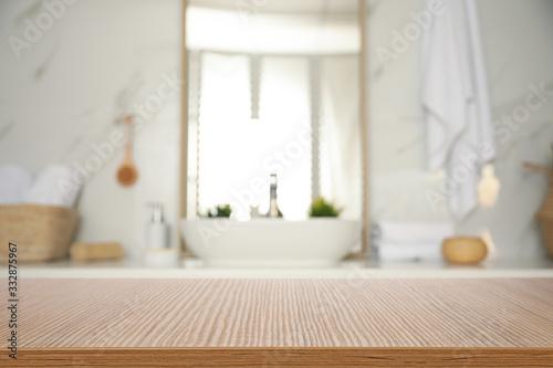 Empty wooden table and blurred view of stylish bathroom interior Slika na platnu