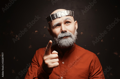 Fotografie, Obraz male cosplay king in a crown with a beard / portrait of a hipster with a gray be