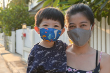 Asian Cute Boy And Woman Mother Wearing Fabric Mask In Outdoor Morning Day Protect Your Self From Air Pollution And Disease Epidemic