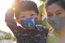 Asian Cute Boy And Woman Mothe...
