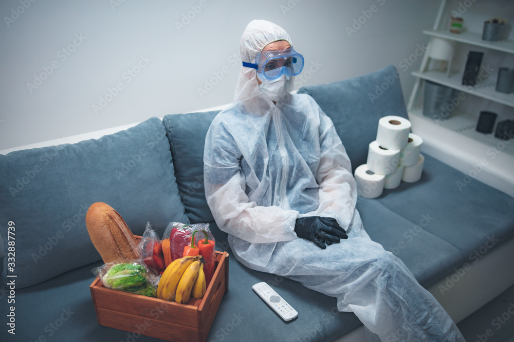 Fototapeta Quarantine and isolation during the virus outbreak - groceries and food in stock, sitting at home, panic, anxious behaviour.