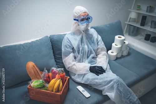 Obraz Quarantine and isolation during the virus outbreak - groceries and food in stock, sitting at home, panic, anxious behaviour. - fototapety do salonu