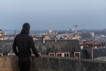 Silhouette Of A Man Looking At A Gorgeous Cityscape From The Castle Of Caen With A Thick Haze Over The City