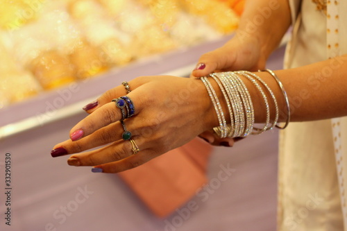 Hands of a woman trying to wear of bangles on her hand Canvas Print