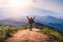 The Abstract Image Of The Hiker Standing On The Cliff For Looking To The Sun And Layer Of Mountains. Doi Luang Chiang Dao, Chiang Dao National Park, Chiang Mai, Thailand.