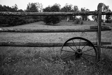 Old Fence And Wagon Wheel