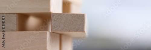 Close-up wooden blocks stacked in construction Wallpaper Mural