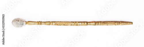 Fototapeta golden magic wand on a white background