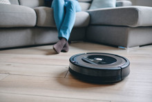 Robotic Vacuum Cleaner On Wood...